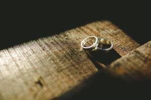 Divorce. Two wedding bands left behind on a table.