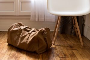 A packed bag sits on the floor.