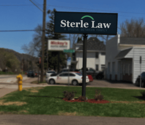 Sterle Law's sign outside their building.