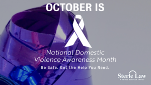 "A spool of purple ribbon for October is National Domestic Violence Awareness Month with the message, ""Be safe. Get the help you need."" Sterle Law"