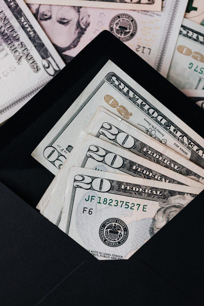 Money in a black envelop